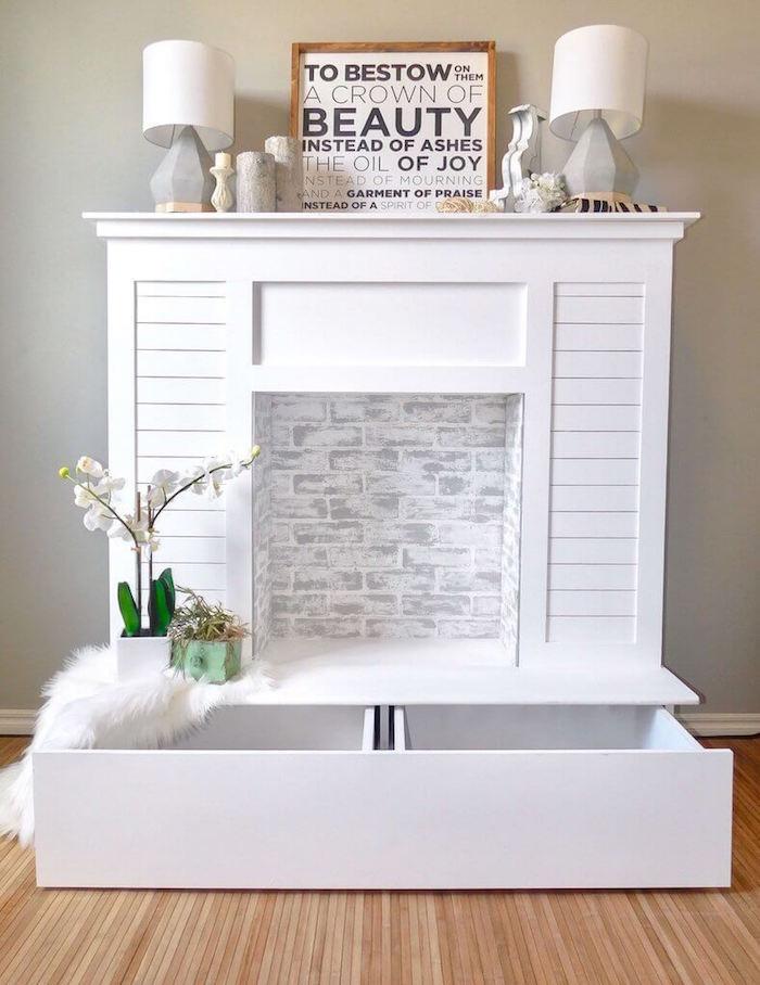 meuble de salon imitation cheminée amovible avec tiroir et faux foyer pour objets déco lampes et cadres