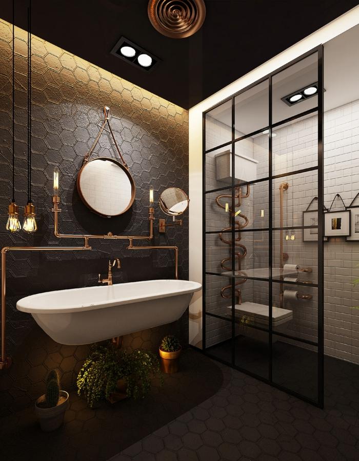 salle de bain esprit industriel, cabine de douche porte atelier, carreaux métro, trois peintures accrochées, tomettes murales, plantes vertes
