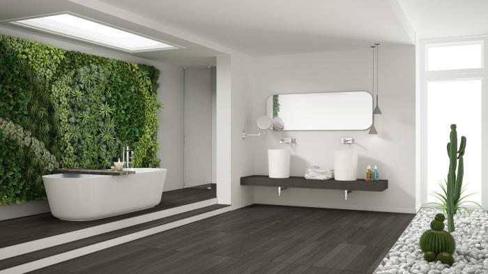 exemple de décoration zen dans une salle de bain spacieuse avec fenêtre de plafond et lumière naturelle, intérieur blanc et gris foncé