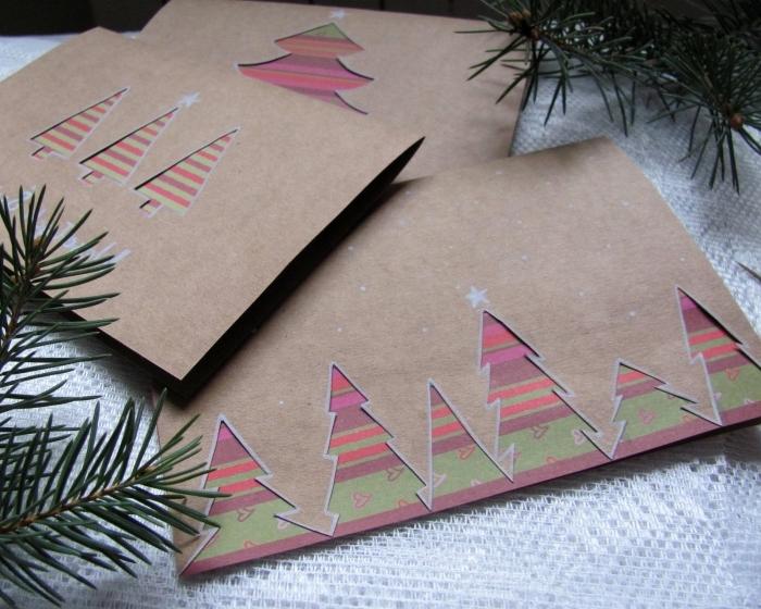 carte de voeux noel en papier kraft brun avec sapins découpés, comment personnaliser une carte Noel en papier cartonné