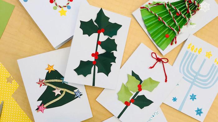 carte de papier blanc avec des motifs houx, sapin de noel, chandelier en papier, idées scrapbooking carte de voeux noel