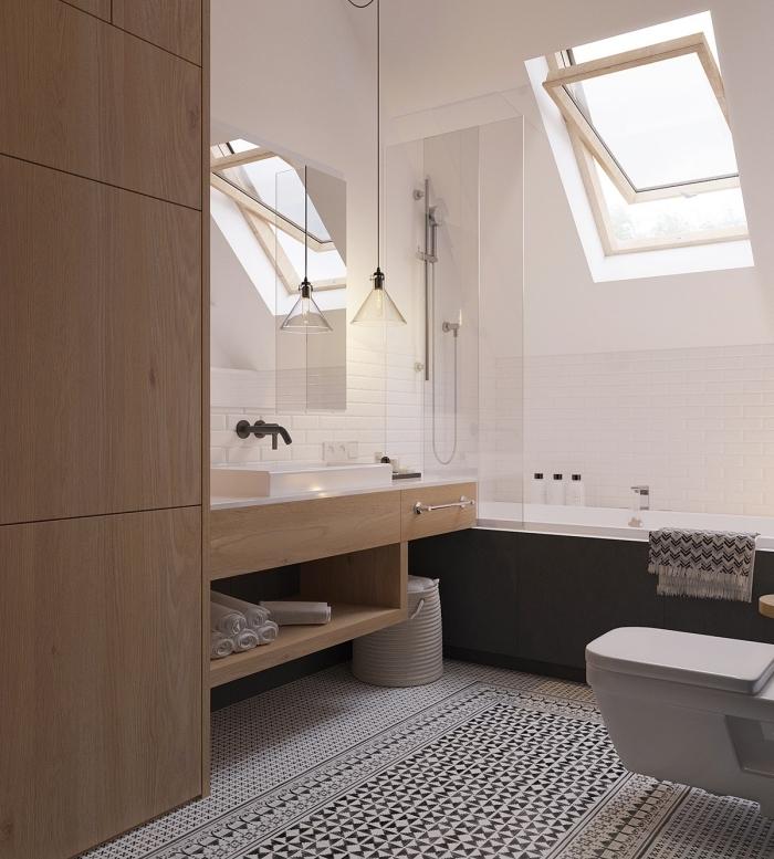 faience salle de bain en blanc, modèle de baignoire blanc et noir pour petit espace, idée déco moderne en blanc et noir avec bois