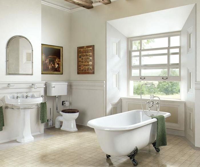 salle de bain blanche aux motifs marron, miroir semi ovale, lavabo colonne sur pied, sol aux carreaux, alcôve fenêtre