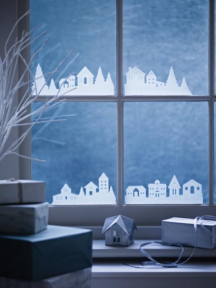 créer une décoration de vitre originale sous forme de petites silhouettes de maisons à coller sur les fenêtres, idée de deco noel a fabriquer soi-même