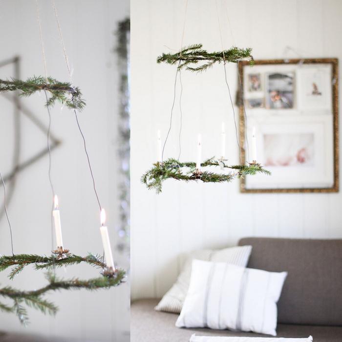 deco mobile de noel scandinave, suspension en branches de pin et des bougies blanches, idee de deco nordique salon gris et blanc