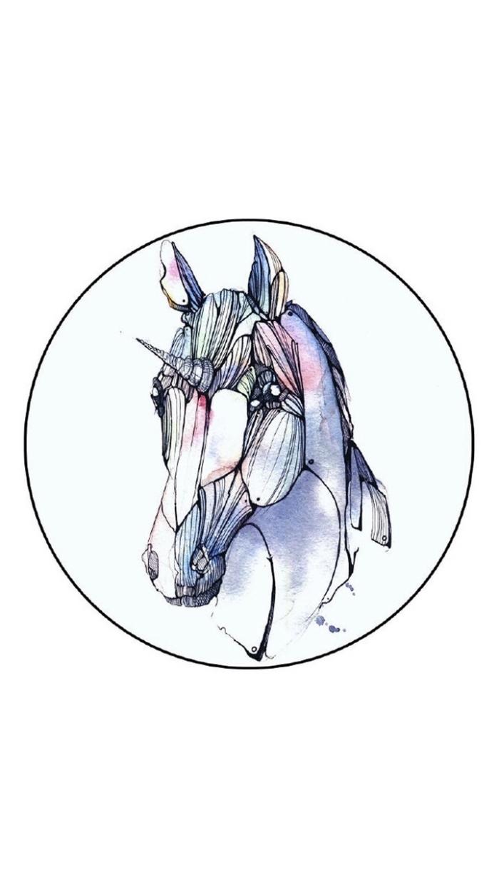 dessin tatouage tête de licorne à l'aquarelle dans un cercle, image licorne poétique d'un joli graphisme