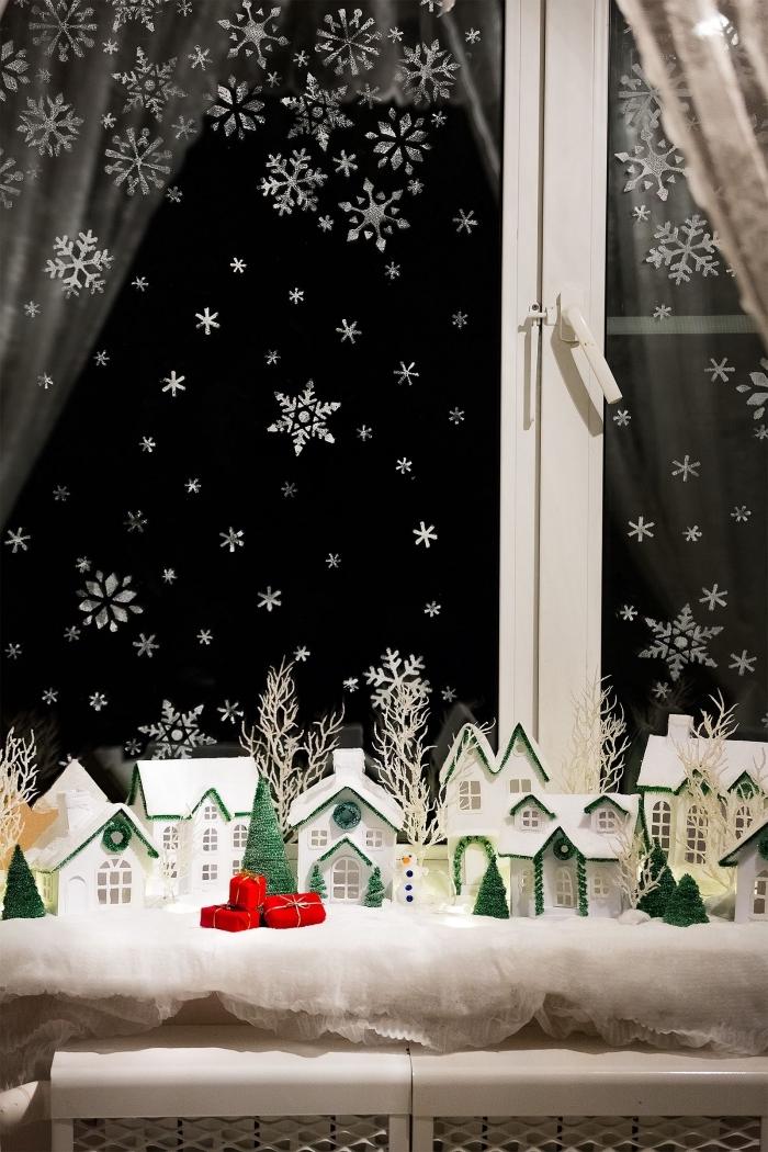 petit village d'hiver avec des maisons en papier comme déco de rebord originale, décoration de noel à fabriquer en papier