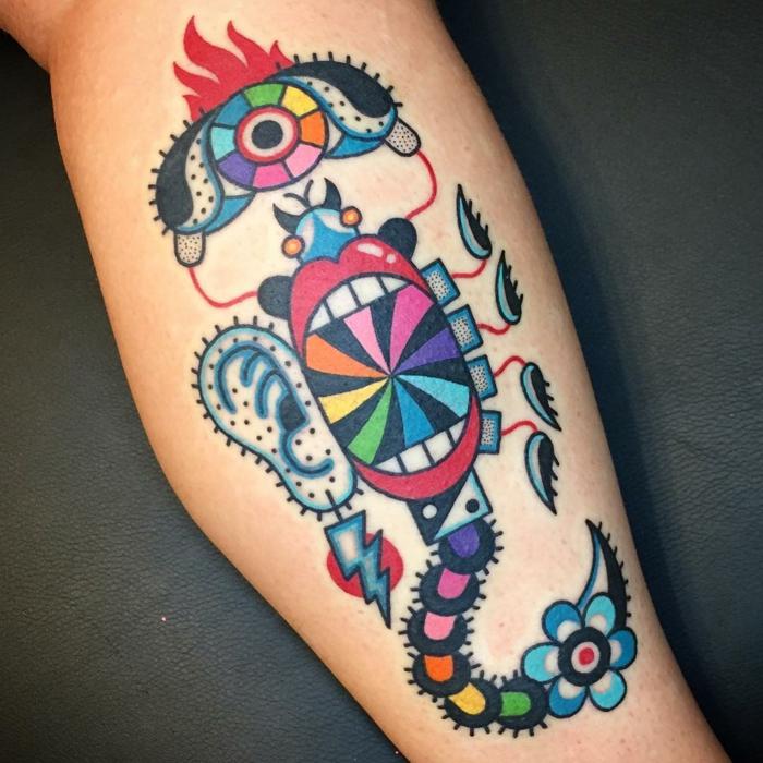 Coloré tatouage graphique abstrait dessin, idée tatouage homme main chouette pour femme aussi, dessin tatouage optique illusion symbolique