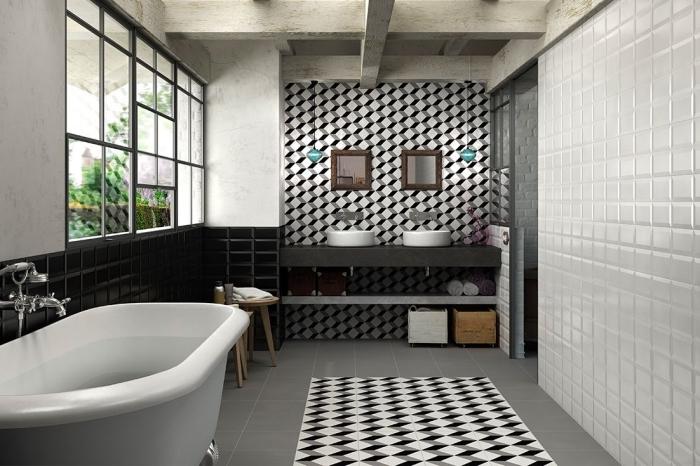 aménagement salle de bains vintage en noir et blanc, crédence imitation carreaux de ciment graphique qui couvre l'intégralité du mur et qui reprend les motifs du revêtement du sol