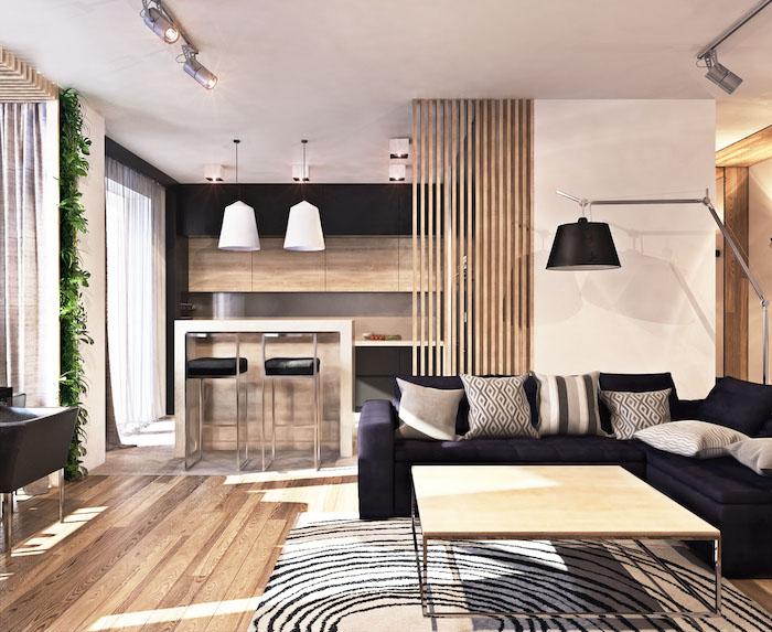 separation cuisine salon originale, idee de cuisine noire et bois, salon avec canapé noir, table basse bois et métal, tapis zebre