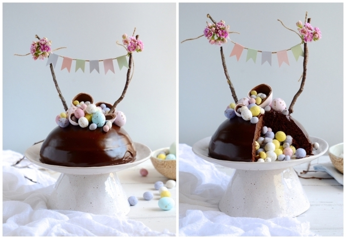 pinata cake au chocolat en forme de dôme recouvert de ganache au chocolat qui renferme des œufs en chocolat, décoré avec une bannière rustique