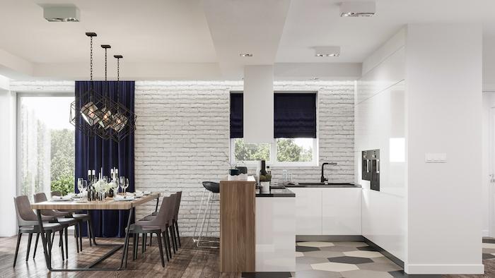 ilot central de cuisine comme separation cuisine salle à manger avec table bois et métal, facade cuisine blanche, parquet et carrelage