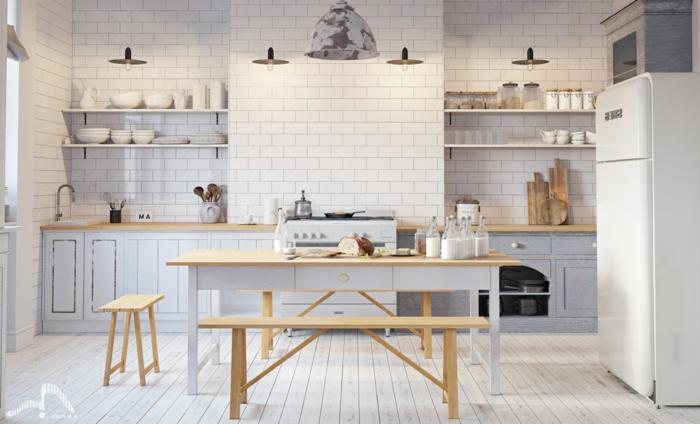 cuisine scandinave en bois et blanc, quatre lampes pendantes, table de repas et banquettes, placards couleur claire
