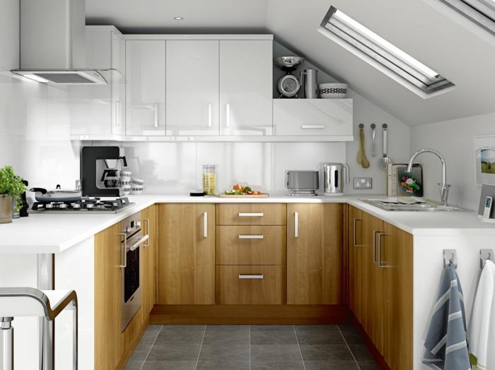 cuisine aménagée en bois et blanc, placards en bois, toit en pente, armoires suspendues, carrelage au sol gris