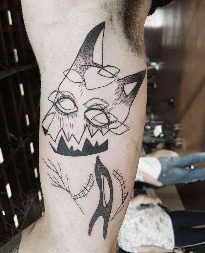 Dessin stylisé tatouage géométrique idée tatouage homme style graphique, masque d'animal originale