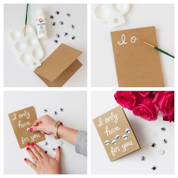 idée de carte saint valentin diy fabriquée dans papier kraft avec texte écrit en feutre blanc et des yeux collés dessus