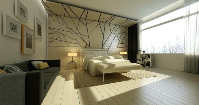 couleur mur chambre blanc et beige, motifs graphiques couleur gris métallique, banquette de lit couleur champagne, tableaux encadrés