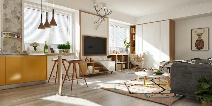 déco cuisine en longueur avec petit îlot, pièce blanc et bois clair avec meubles bois, cuisine avec armoires jaune