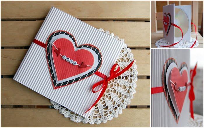 carte simple a faire soi meme en papier blanc avec un coeur rouge en papier et tissu et ruban rouge décoratif