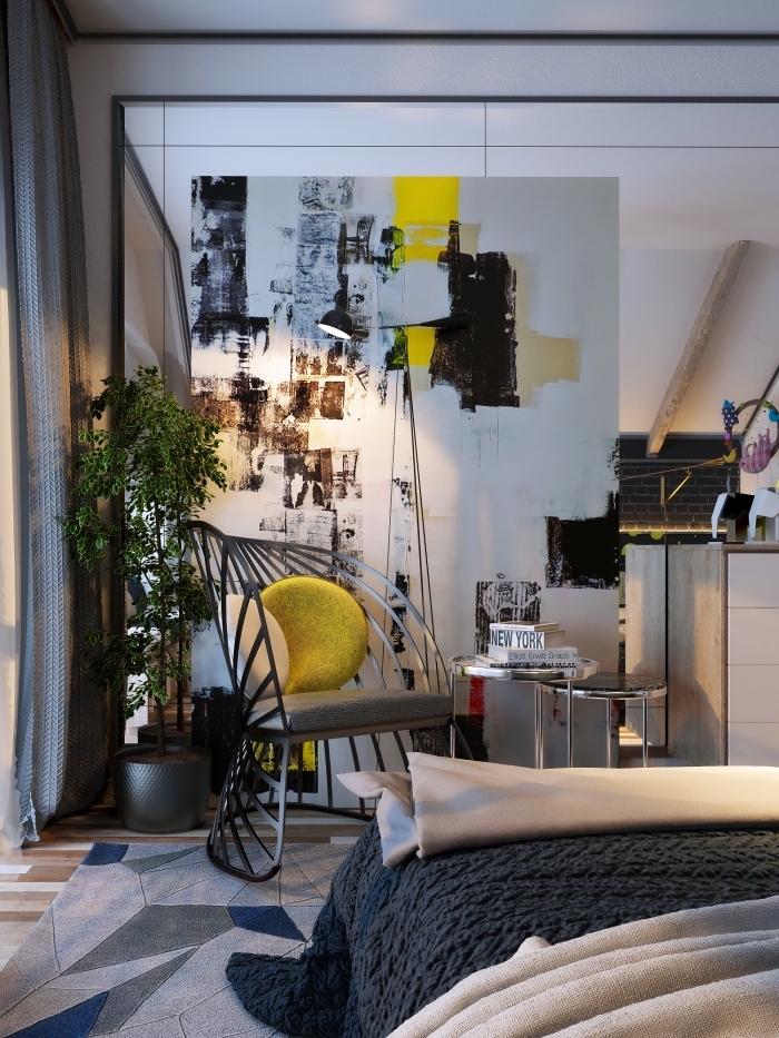 comment aménager un petit studio avec une séparation pièce art, chambre à coucher blanc et gris foncé avec accents jaune