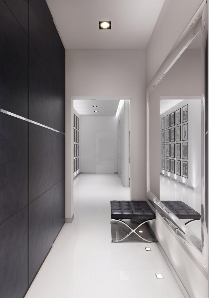 decoration couloir long et étroit blanc avec un mur d'accent noir et un grand miroir qui élargit visuellement l'espace