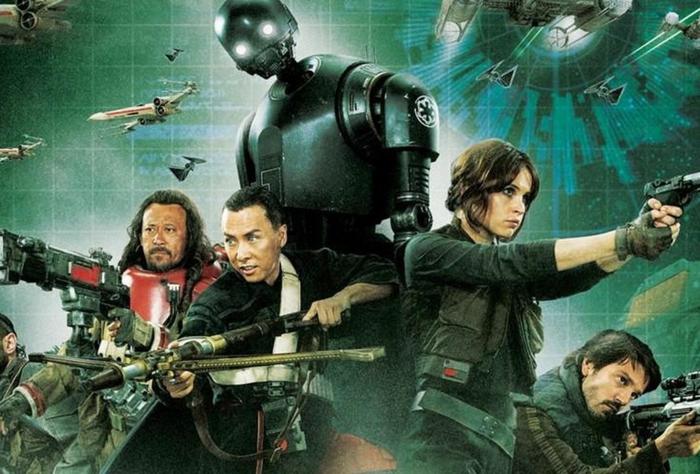 Tous les héros principaux du prequel Rogue One qui portent des armes sur un fond intéressant