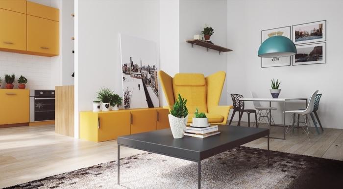 design intérieur moderne avec meubles en blanc et gris, accents jaune moutarde intérieur, fauteuil lecture jaune moutarde