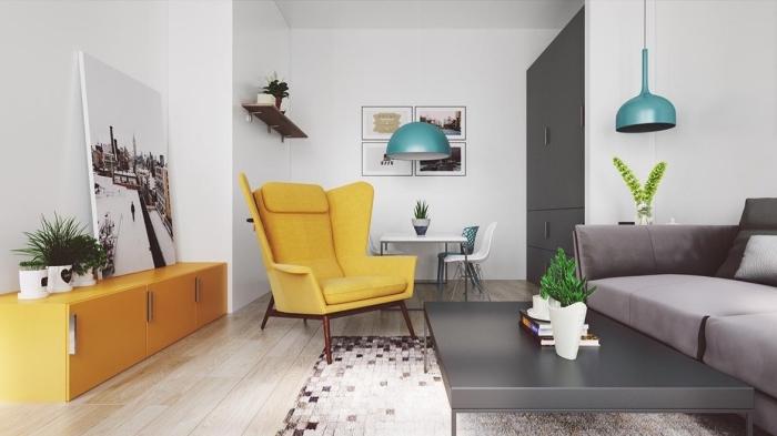 design intérieur moderne de style scandinave, déco salon blanc avec parquet clair et canapé gris, modèle de fauteuil couleur jaune moutarde