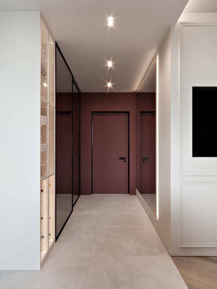 astuce peinture couloir pour apporter de la profondeur à l'espace, porte d'entrée et mur au fond peints en couleur lie de vin contrastant avec les murs blancs