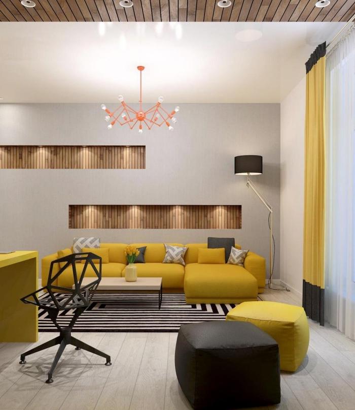 exemple de deco salon gris moderne, idée rangement mural avec niches de bois et éclairage led, lustre corail