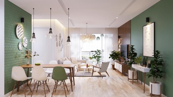quelle couleur associer au vert, déco de salon blanc avec pan de mur en panneau bois foncé et peinture vert foncé