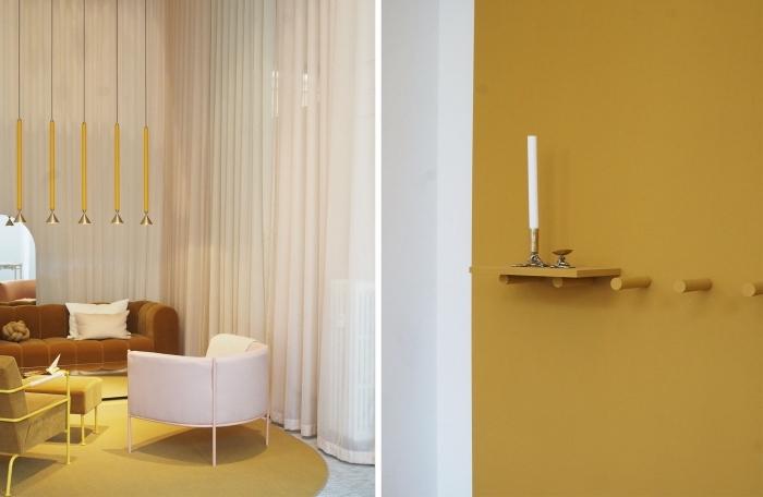 design intérieur moderne avec murs et objets de couleur ocre, décoration de salon contemporain avec canapé en velours marron et coussins