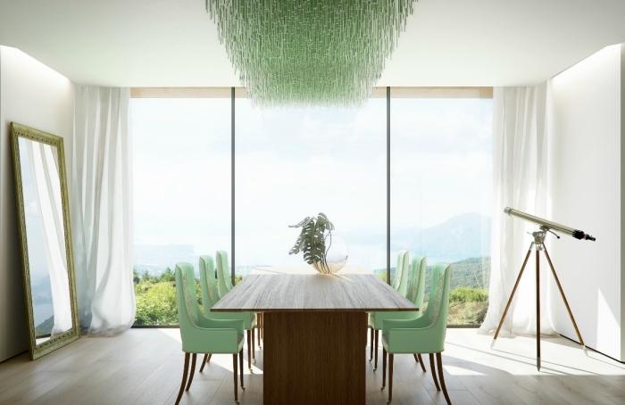exemple de déco avec meubles et objets vert pale, aménagement salle à manger avec table bois foncé et chaise vert pâle