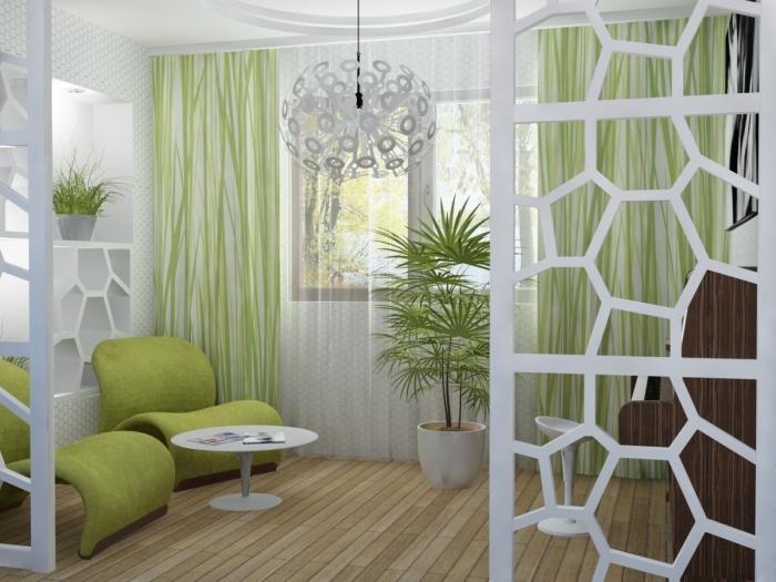petit salon au plancher bois et murs habillés en papier peint blanc et vert, déco pièce en blanc avec objets de couleur vert amande ou vert anis