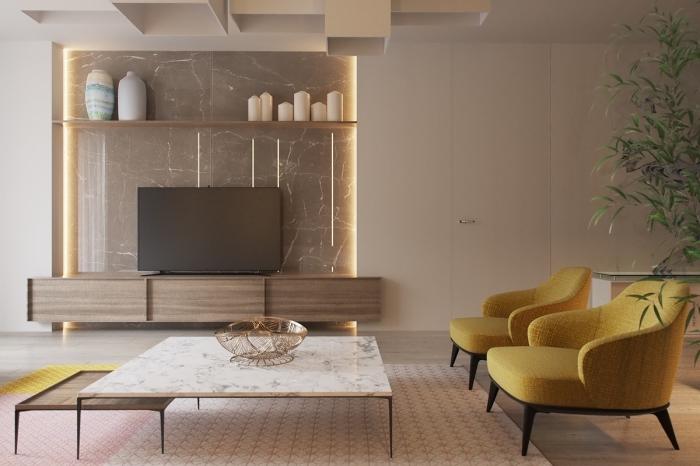 design intérieur moderne avec pan de mur marbre et table double plateau en marbre blanc et bois à finitions noir mate, idée fauteuil ou canapé jaune moutarde