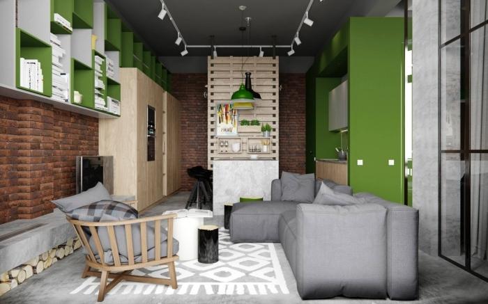 aménagement petit studio de style industriel aux murs à design briques, meubles rangement blanc et vert, couleur vert anis dans la déco