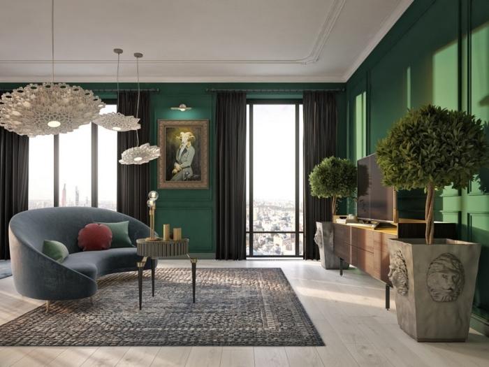 idée peinture vert de gris ou vert foncé dans un salon au parquet bois clair, modèle de canapé gris foncé avec coussins verts