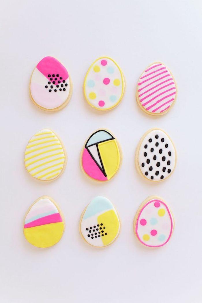 Biscuits décorés joliment avec pate a sucre coloré aux couleurs neon modernes, carte joyeuses pâques, belle image joyeuses paques