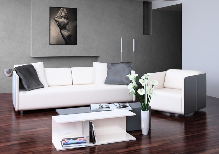 aménagement salon aux murs à texture béton, mobilier salon moderne avec fauteuil canapé et double table basse en blanc et gris