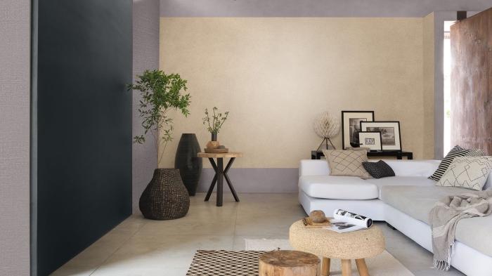 comment aménager un salon moderne avec meubles bois, idée enduit décoratif intérieur à effet pierre, pan de mur salon en gris anthracite