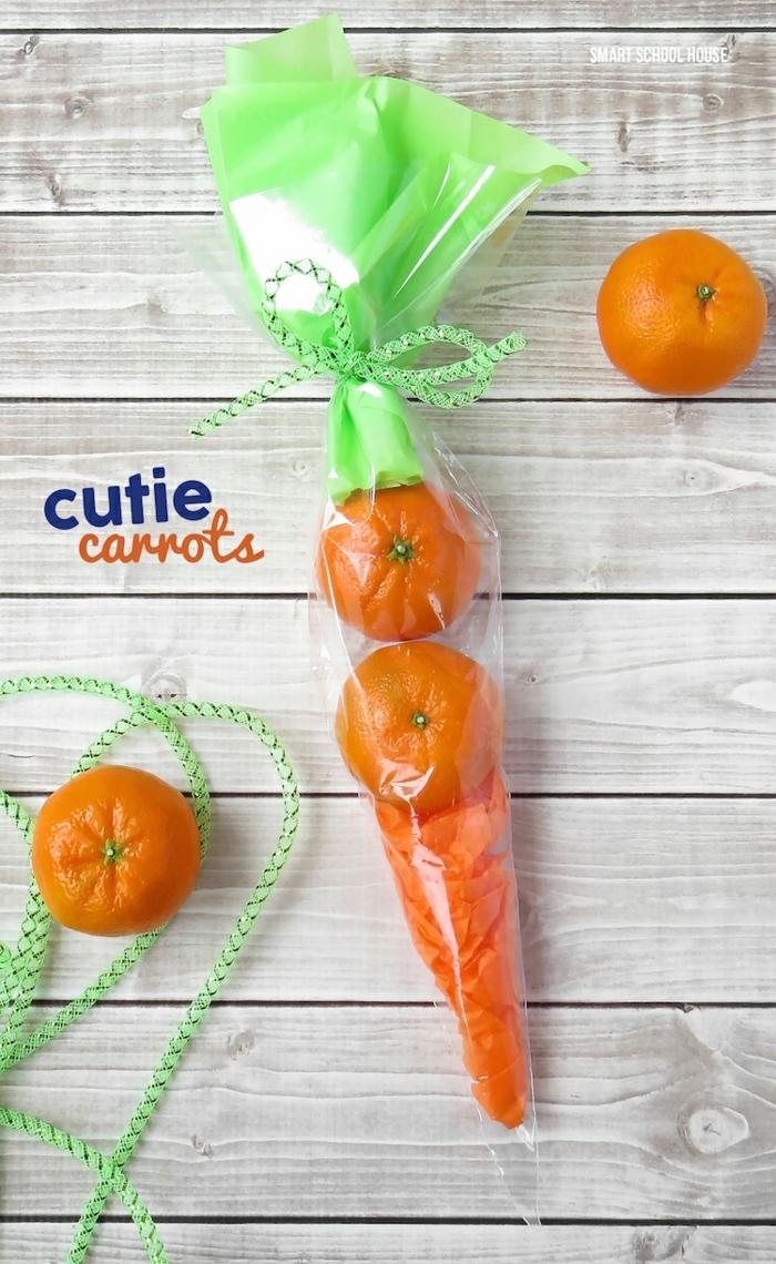 carotte orange fabriqué avec clémentines et papier léger décoratif mis en cellophane