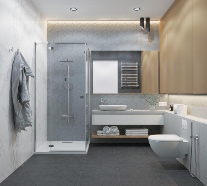 design intérieur moderne, carrelage gris clair pour murs dans une salle de bain contemporaine, cabine de douche en verre