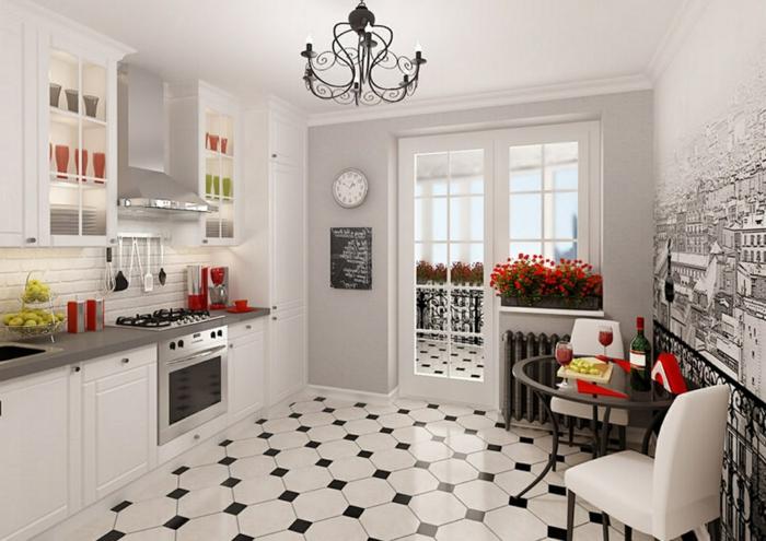 cuisine accueillante, carrelage damier, petite table bistrot ancienne, chandelier fer forgé, fleurs rouges