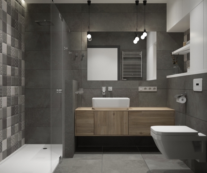 modèle de salle de bain grise avec meubles haut rangement mural en blanc, cabine de douche avec carreaux blanc et gris