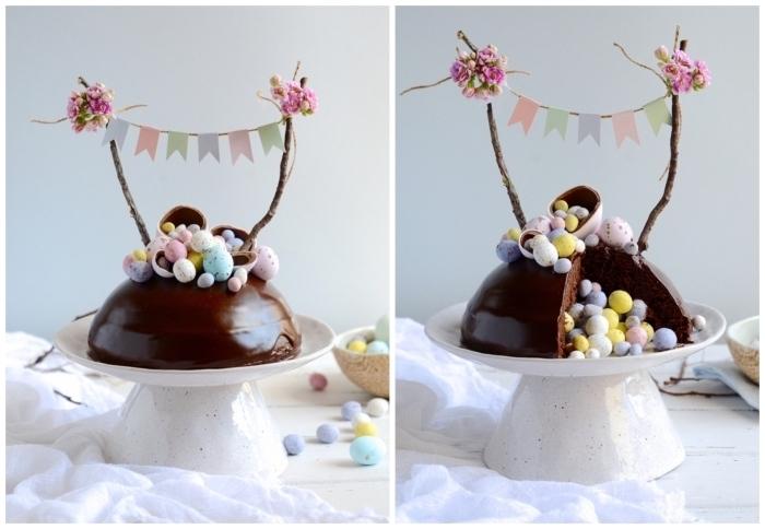 recette de gateau de paques au chocolat facile et gourmand, dôme au chocolat qui cache des œufs de pâques dans son cœur, décoré avec un cake topper naturel de brindilles en bois et de fleurs