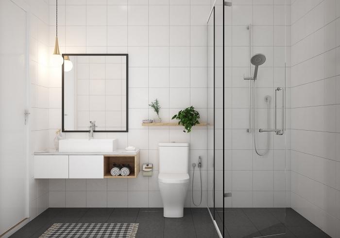 décor salle de bain contemporaine aux murs en carreaux blancs avec plancher gris foncé, idée rangement mural
