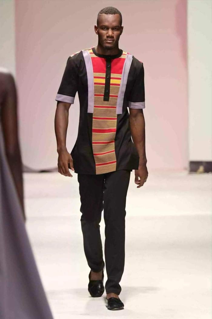 modele pagne africaine homme, pantalon noir, tunique imprimé africain, jeune homme au podium