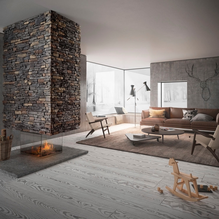 idée aménagement salon avec mur en pierre, design intérieur salon gris et bois avec peinture effet beton ciré