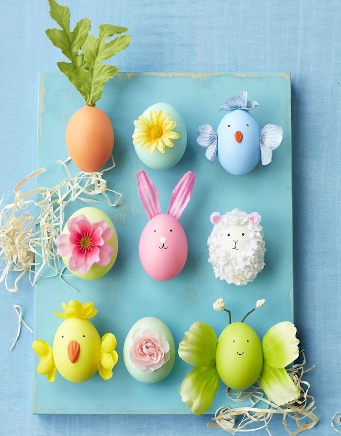 oeufs colorés et décorés à motifs fleuris de fleurs pour figurer un motif lapin, papillon, poussin et agneau