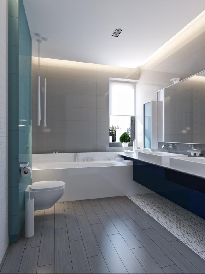 comment décorer une salle de bain gris et blanc avec mur de couleur bleu, exemple agencement salle de bain avec baignoire